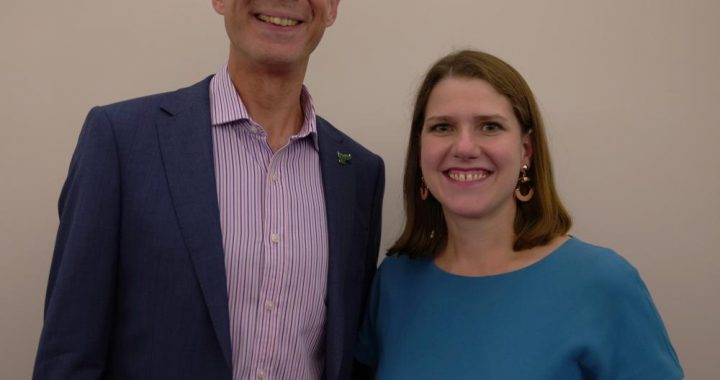 Matthew standing with Jo Swinson